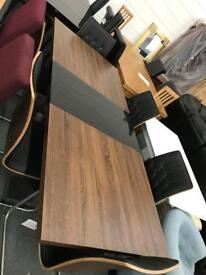 Extending Table 6 Cantilever Chairs