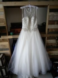 Size 18, beautiful dress. Typical marks under the train but it can't be seen once on. Buyer collects