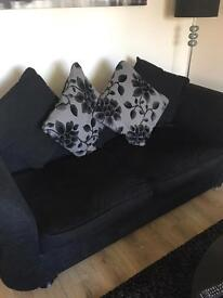 DFS black 2 seater sofa and 'swivel' chair