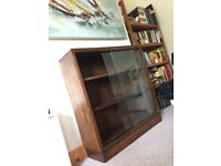 Old wooden dark bookcase with glass sliding doors