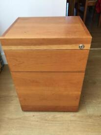Wooden office filing cabinet on wheels