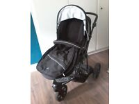 3 wheeler stroller with foot and rain cover.