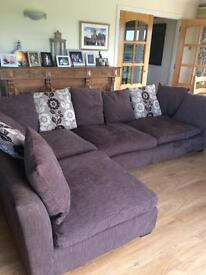 Brown corner sofa with footstool