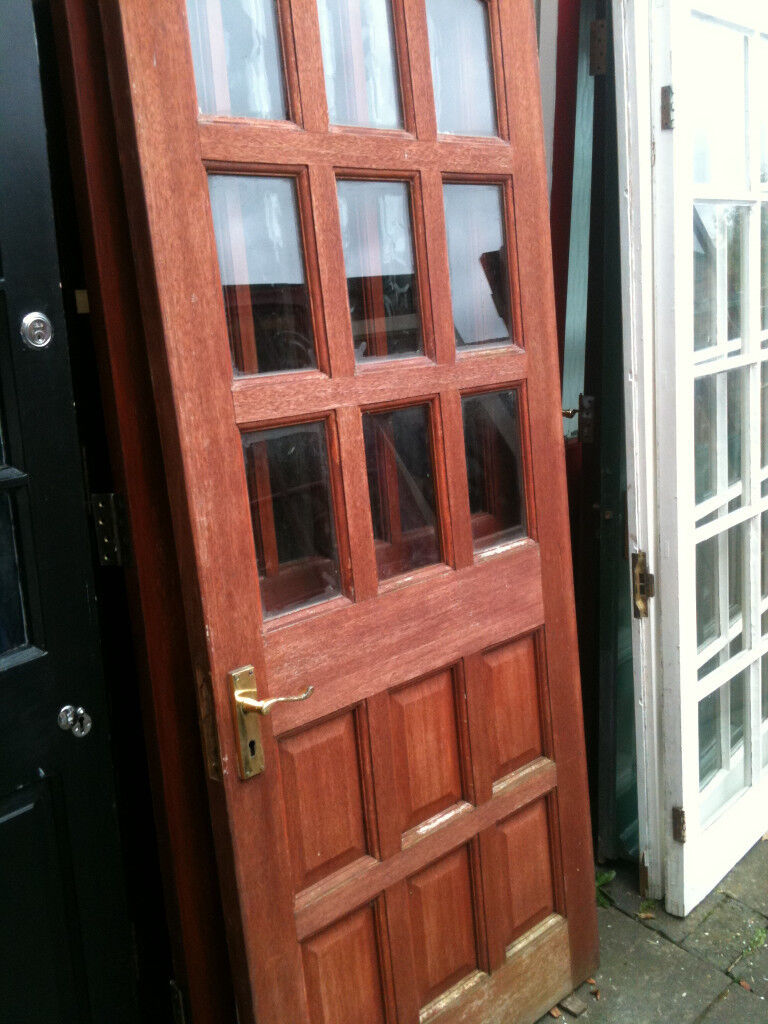 Exterior hardwood door with clear glass squares