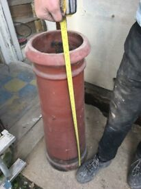 Two tall clay chimney pots