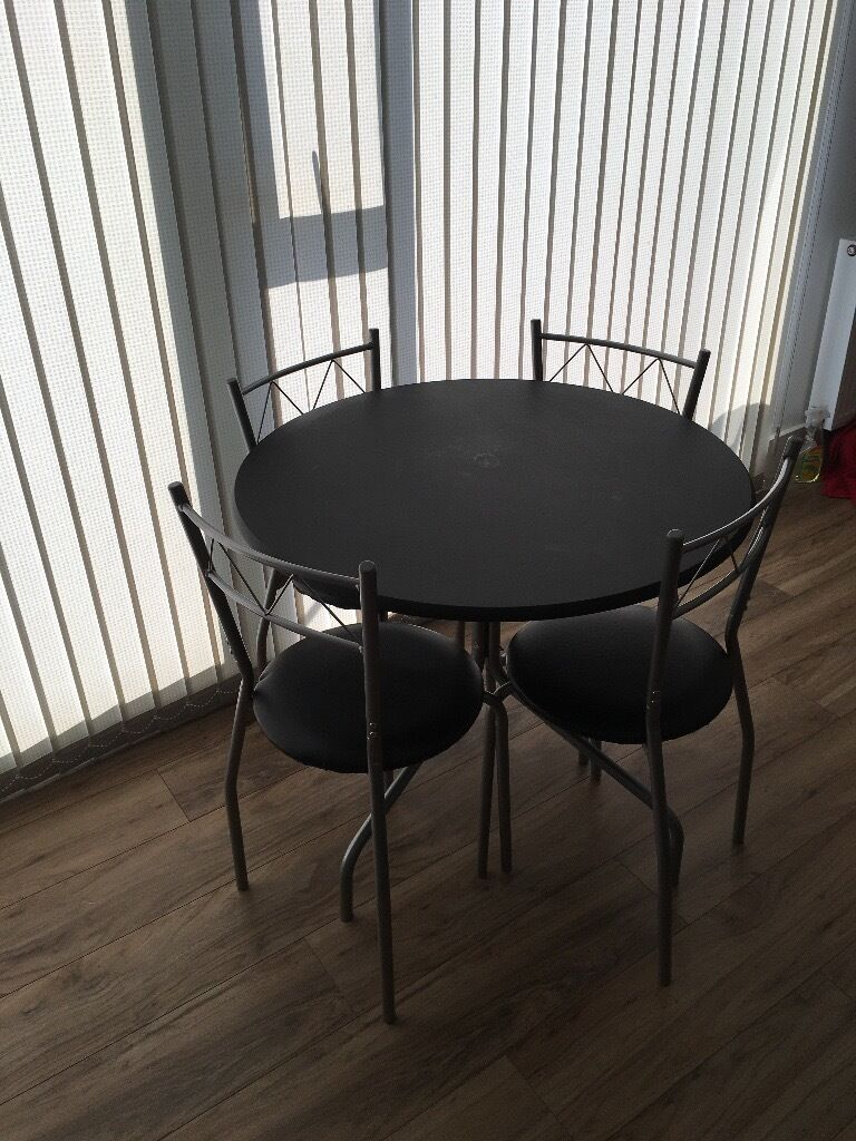 Dining set Table with 4 chairsin Brighton, East SussexGumtree - Dining set with 4 chairs, in good condition. The table does have some circles on it from cups that dont seem to come off. Otherwise in good condition. Bought from Homebase last year. Collection only, near Sainsburys on Lewes Road Brighton