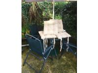 Garden table with 4 fold up chairs and cushions and parasol