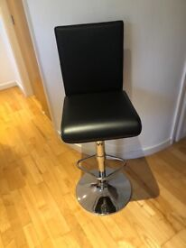 Two black and chrome bar stools