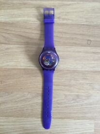 Purple Swatch watch, used