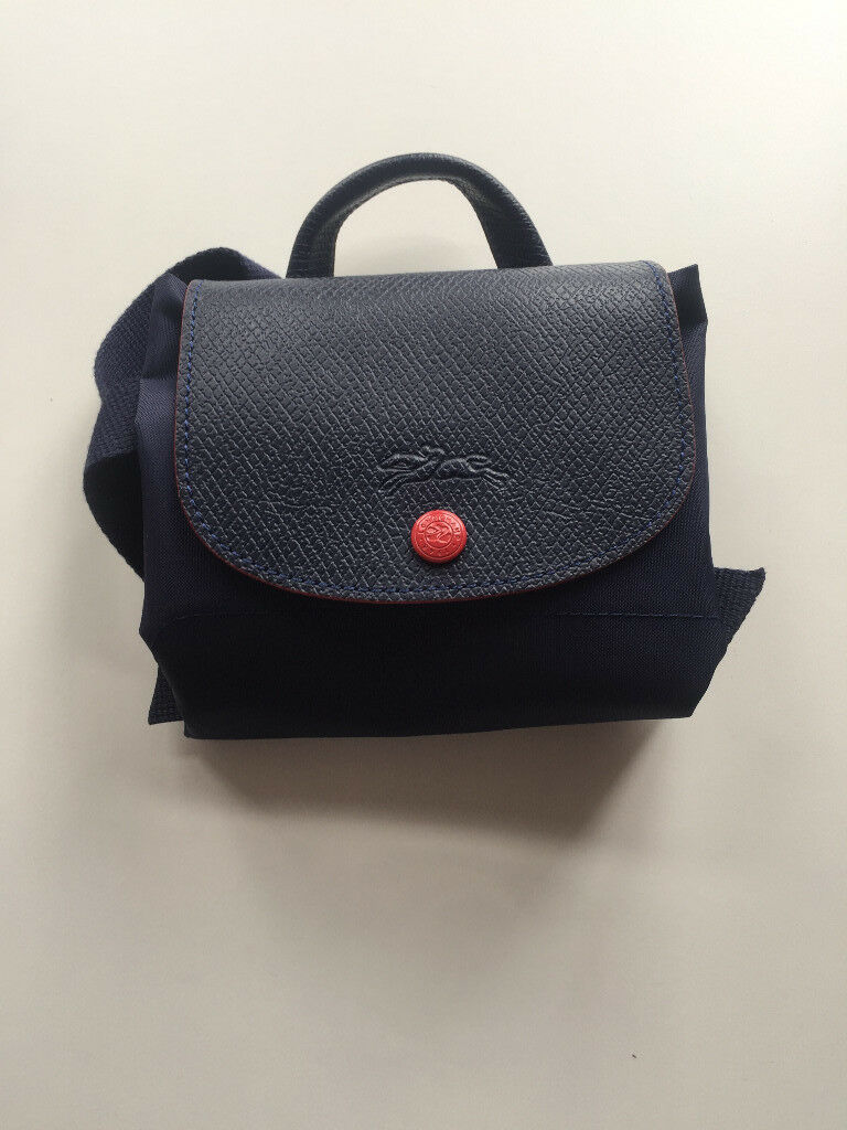 9ee167546efa LONGCHAMP Le Pliage backpack limited edition - blue canvas with red logo.  Used twice.