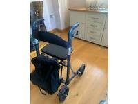 Four wheel Walker with seat and bag