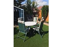 Large table and four relaxer chairs