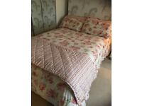 Pink floral duvet cover set with matching curtains and tie backs