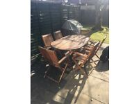 Garden wooden table and chairs - £30