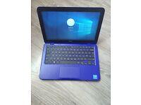 Blue dell Inspiron laptop