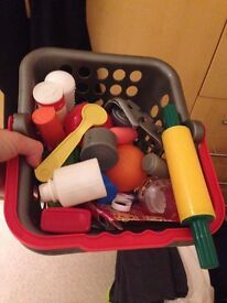 Kids plastic shopping basket filled with pretend food and utensils, good condition