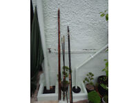 A collection of 3 vintage wooden fishing rods for sale