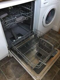 Bosch white full sized dishwasher.