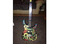 Rockster guitar in skull and dragon design