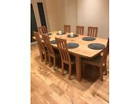 Nearly new solid oak dining table with 7 chairs, perfect condition