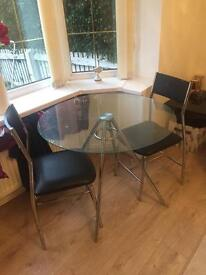 Glass top round table with 2 chairs