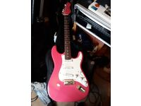 Encore Strat type guitar with soft case.