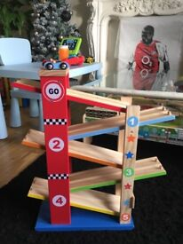 Wooden cars racing ramp with cars