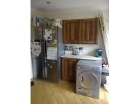 Kitchen for sale, walnut units, quartz worktops, silver appliances