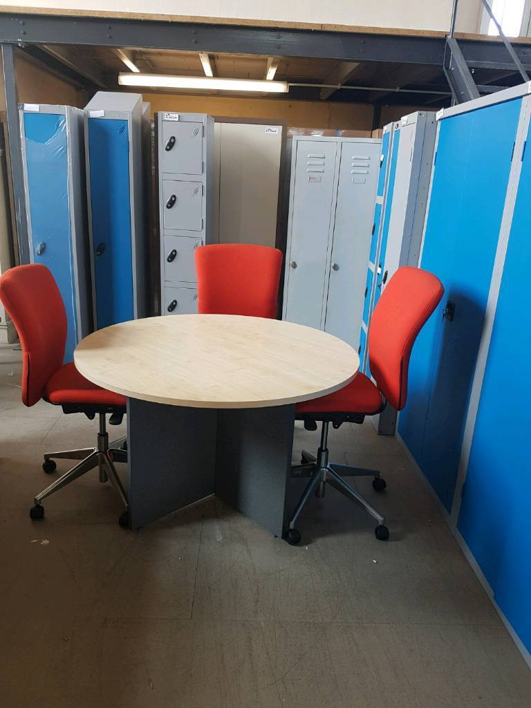 Used boardroom conference table in maple. 1200. With 3 used orange box chairs.