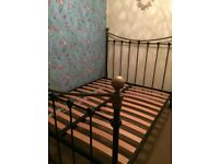 Black wrought iron double bed stead