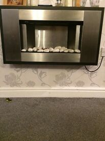 Electric wall mounted fake fire with stones
