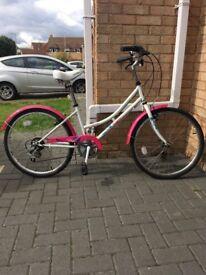 Girls pink and white pushbike