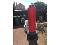 Water/sand filled punch bag with gloves