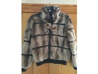 Stunning girls fur jacket brand new with labels from Next age 11/12 from smoke free home