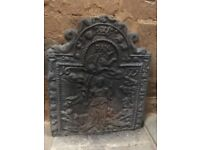 Antique metal fireplace back plate