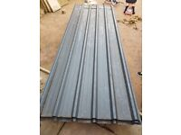 metal sheets with poles and joists