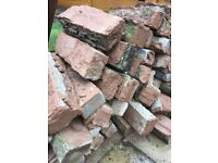 Old used decorative garden patio bricks and old slabs