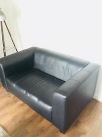 2 seater black faux leather sofa.