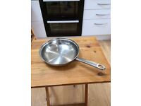 Stainless steel frying pan with heavy base and hollow steel handle