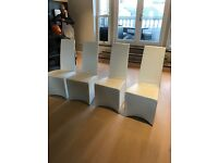 Four Italian leather dining chairs