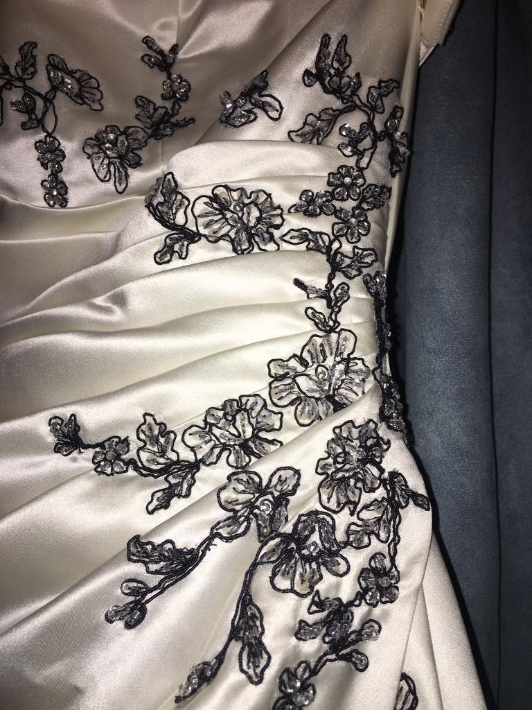 BARGIN size 14 wedding dress for salein Harrow, LondonGumtree - Ivory and black sequin flower detailed wedding dress for sale !!! Wedding trail contains the same design so the design flows through out this strapless beautiful dress! Cheap dress in amazing condition!