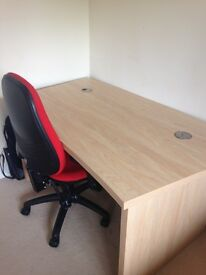 Computer chair and solid desk.