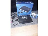 PlayStation 3 Slim with 2 Controllers & 16 GAMES