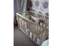 cot and bedding and bumpers