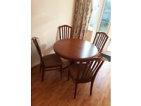 Small round solid wood dinning table with 4 chairs
