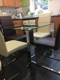 Glass/Chrome dining table and chairs