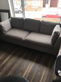 Light grey IKEA modern contemporary sofa