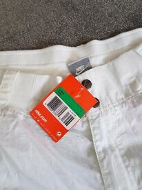 Nike 3/4 length trouser. One brand new pair white and a red worn pair in great condition.