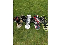 4 x Oxelo Skateboards £12 each & 4 x Oxelo Helmets £8 each