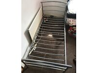 Silver metal single bed frame, used condition and has a slight kink, but should be Ok to use.